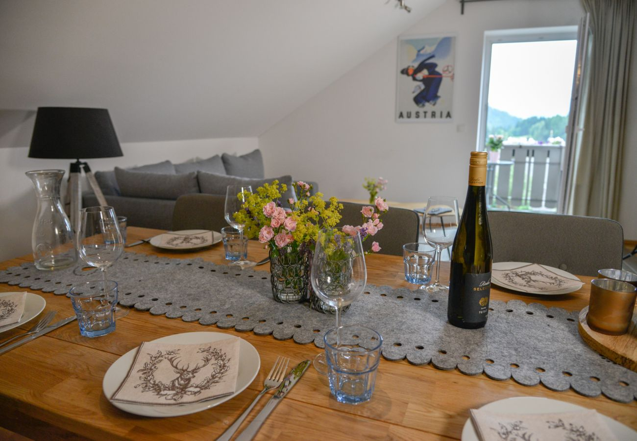 table set in the holiday home Grimming Lodge Windroeschen in Tauplitz