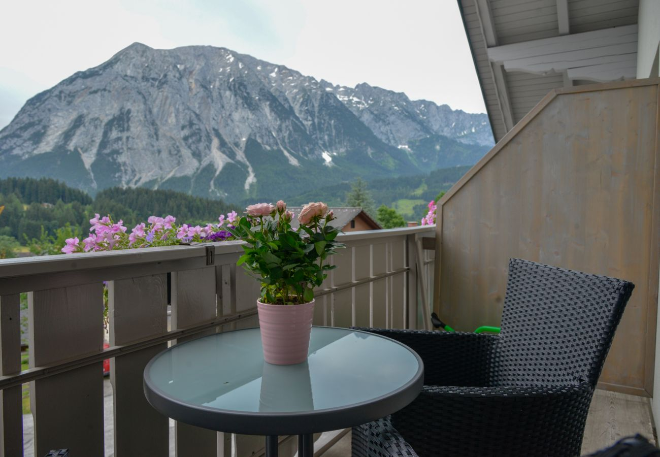 balcony with seating area in the holiday home Grimming Lodge Windroeschen in Tauplitz