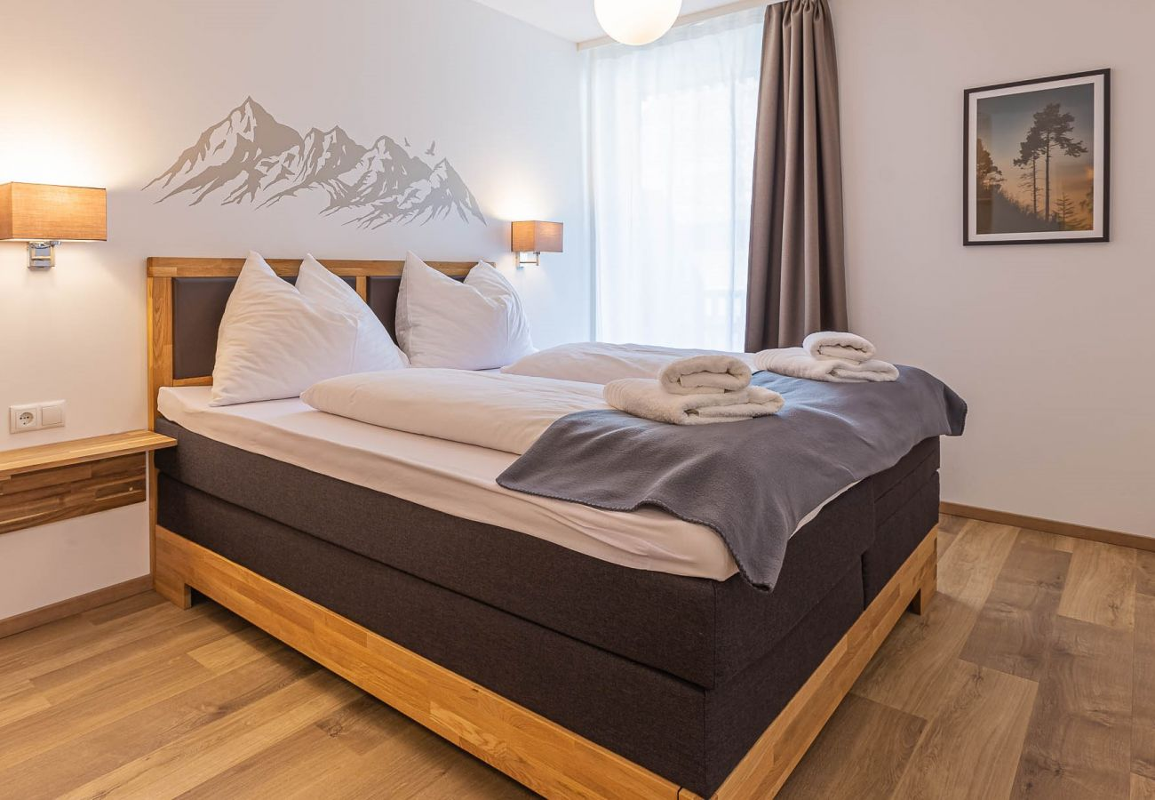 bedroom in the holiday home Grimming Lodge Distel in Tauplitz
