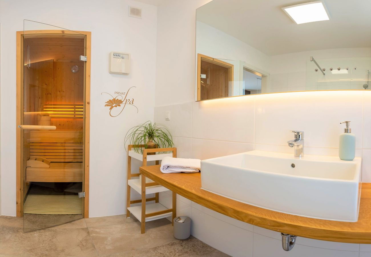 bathroom view to the sauna in the holiday home Grimming Lodge Distel in Tauplitz