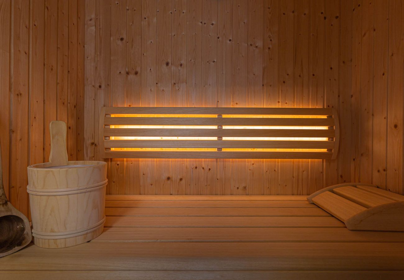 view into the sauna in the holiday home Grimming Lodge Distel in Tauplitz