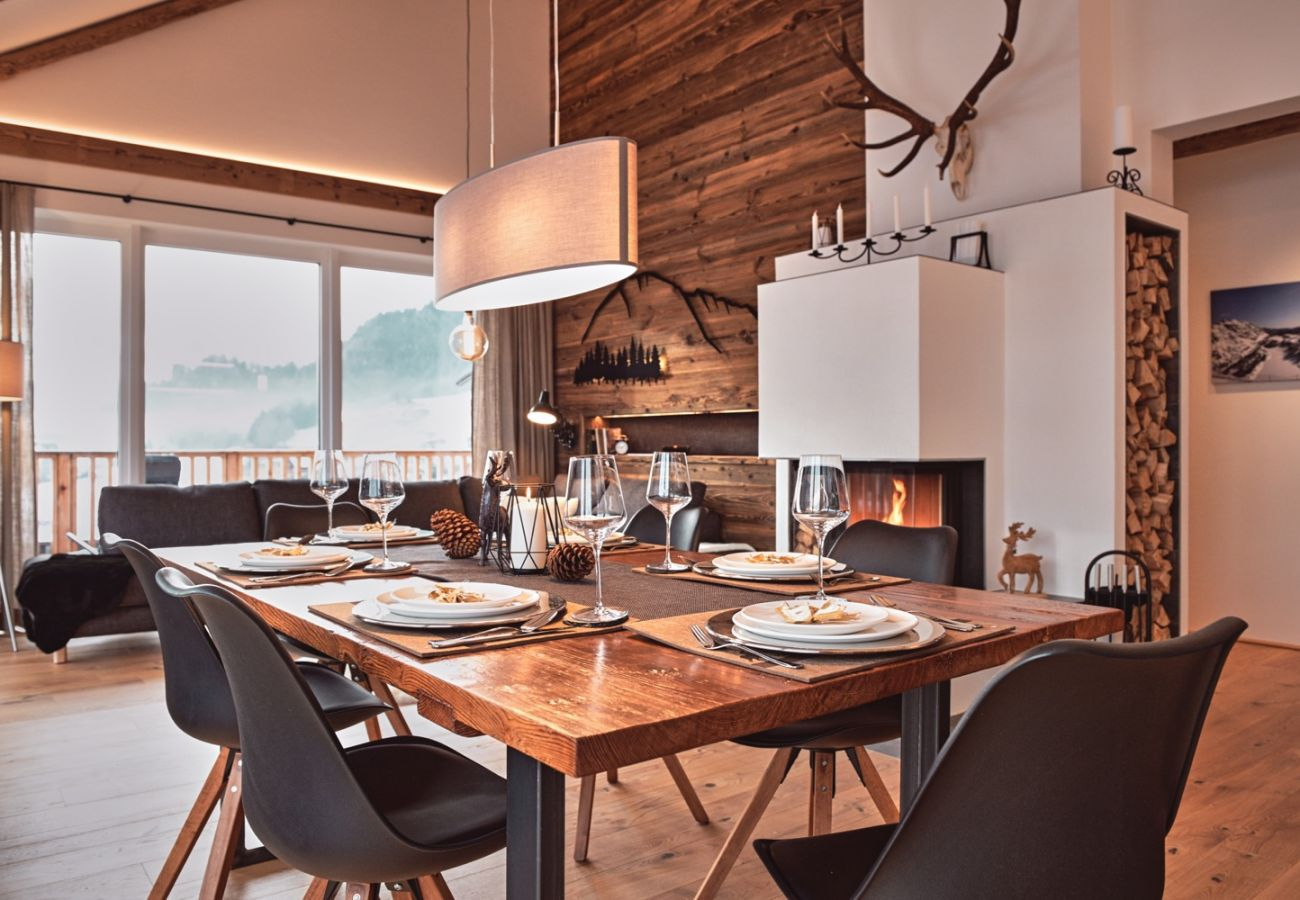 Living area with an alpine style in the Holiday Home Penthouse Grimming Adler Lodge D7.1 in Tauplitz