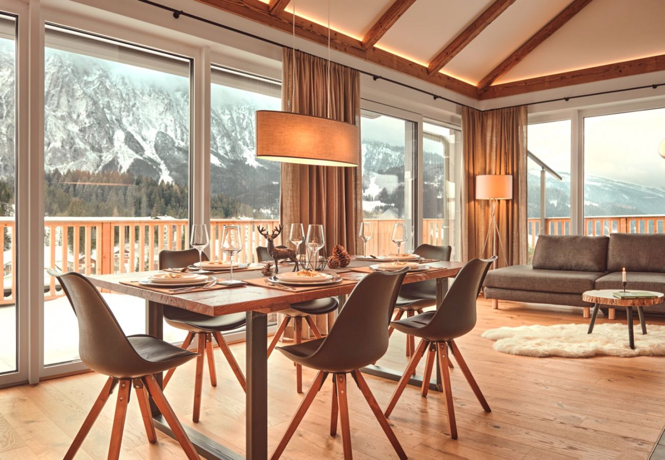 dining table with view over the mountains in the holiday home flat Penthouse Grimming Adler Lodge D7.1 in Tauplitz