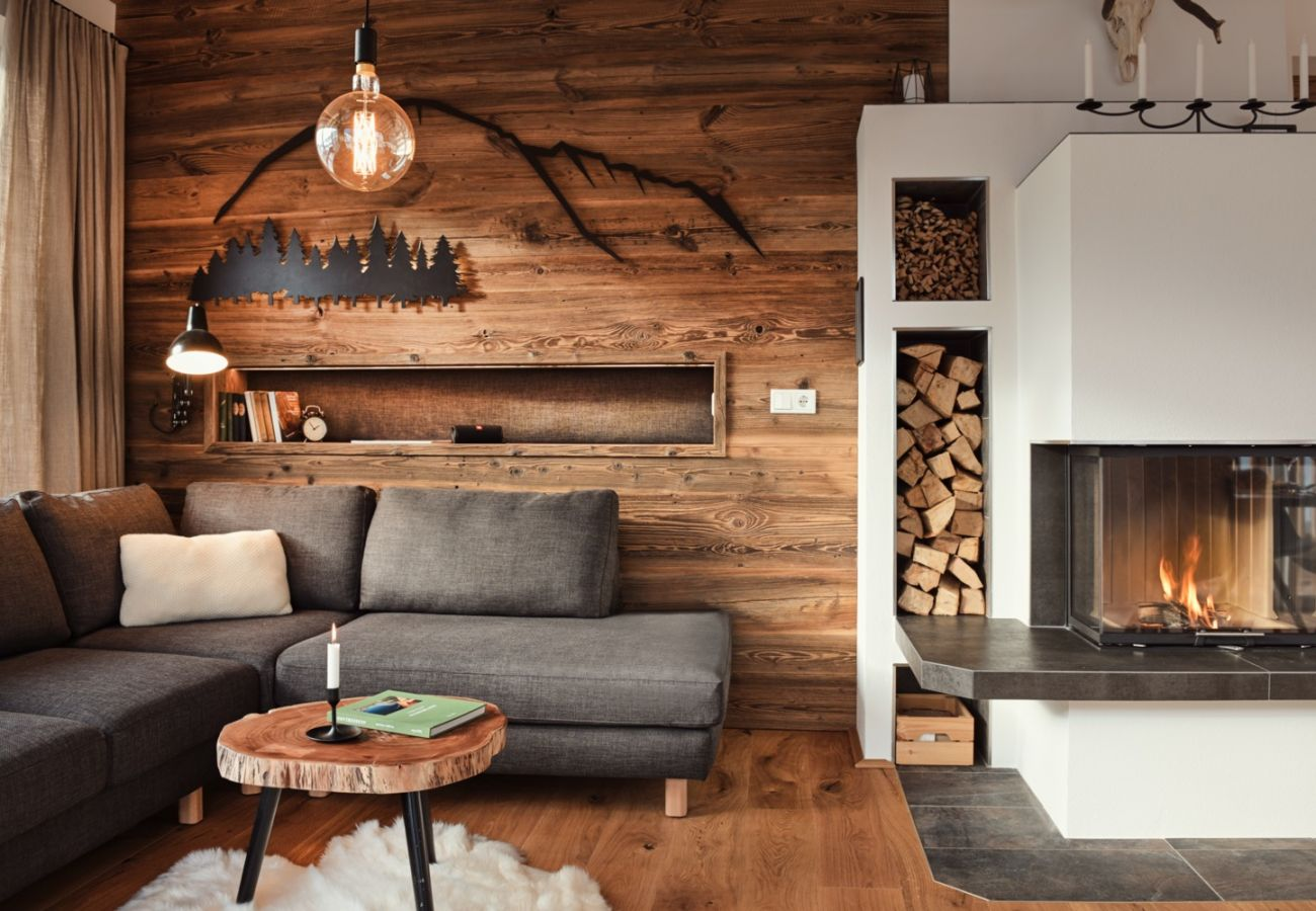 Living room with an alpine style in the Holiday Home Penthouse Grimming Adler Lodge D7.1 in Tauplitz