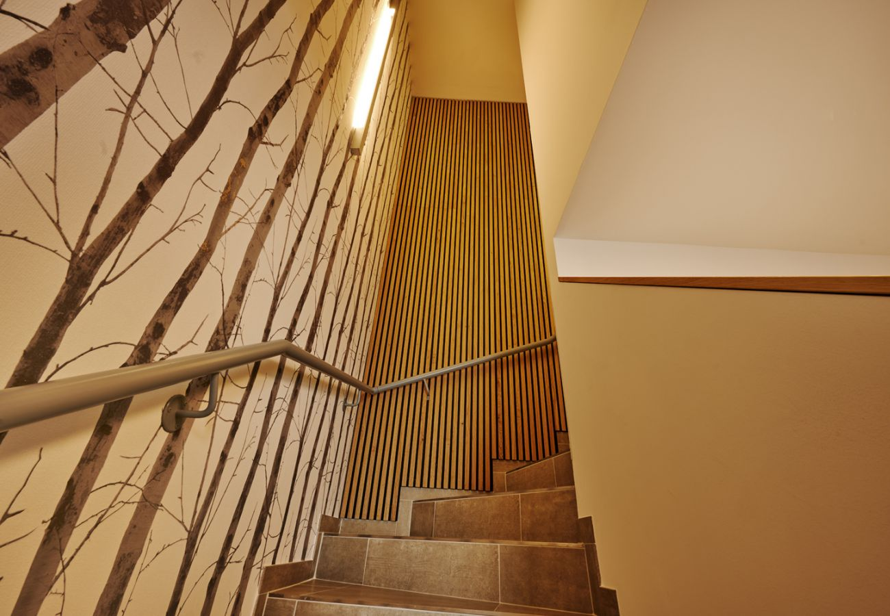 stairs leading up to the holiday flat Adler Auszeit Lodge D6 in Tauplitz