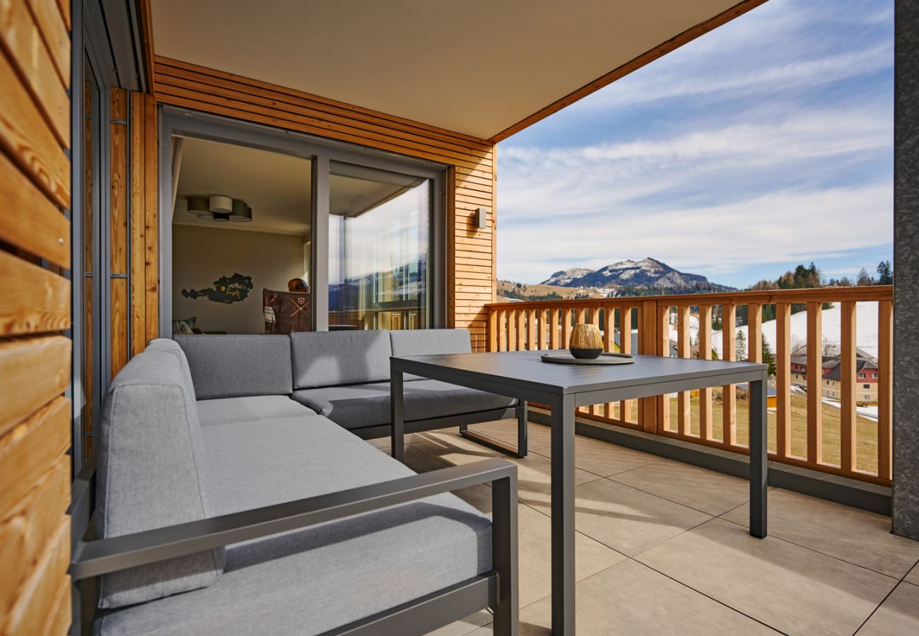 big Terrace with an seating area in the holiday home flat Adler Lodge D6 in Tauplitz