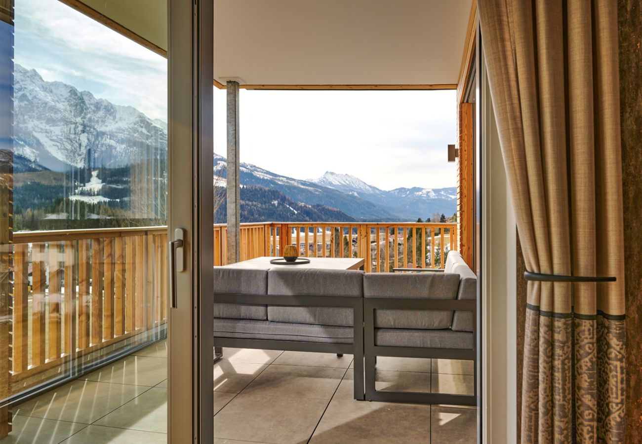 Terrace with an seating area in the holiday home flat Adler Auszeit Lodge D6 in Tauplitz