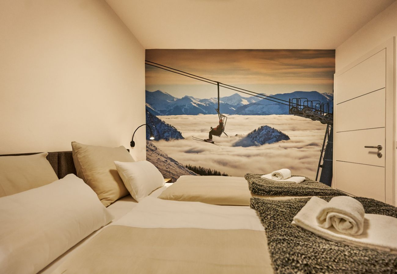 Bedroom 2 with Walldecoration Alpine Style in the holiday home flat Adler Auszeit Lodge D6 in Tauplitz