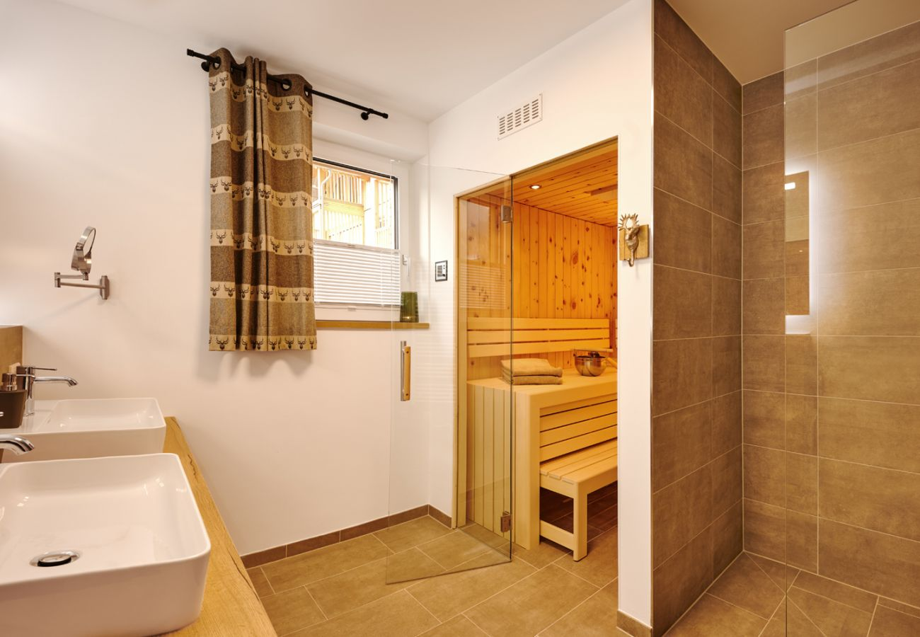 Bathroom with a rain shower and Sauna in the Holiday home flat Adler Auszeit Lodge D6 in Tauplitz