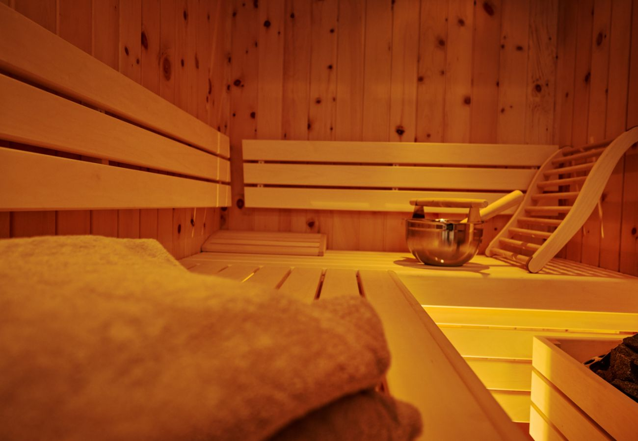 Bathroom with rain shower, Window and Sauna in the Holiday home flat Adler Lodge D6 in Tauplitz