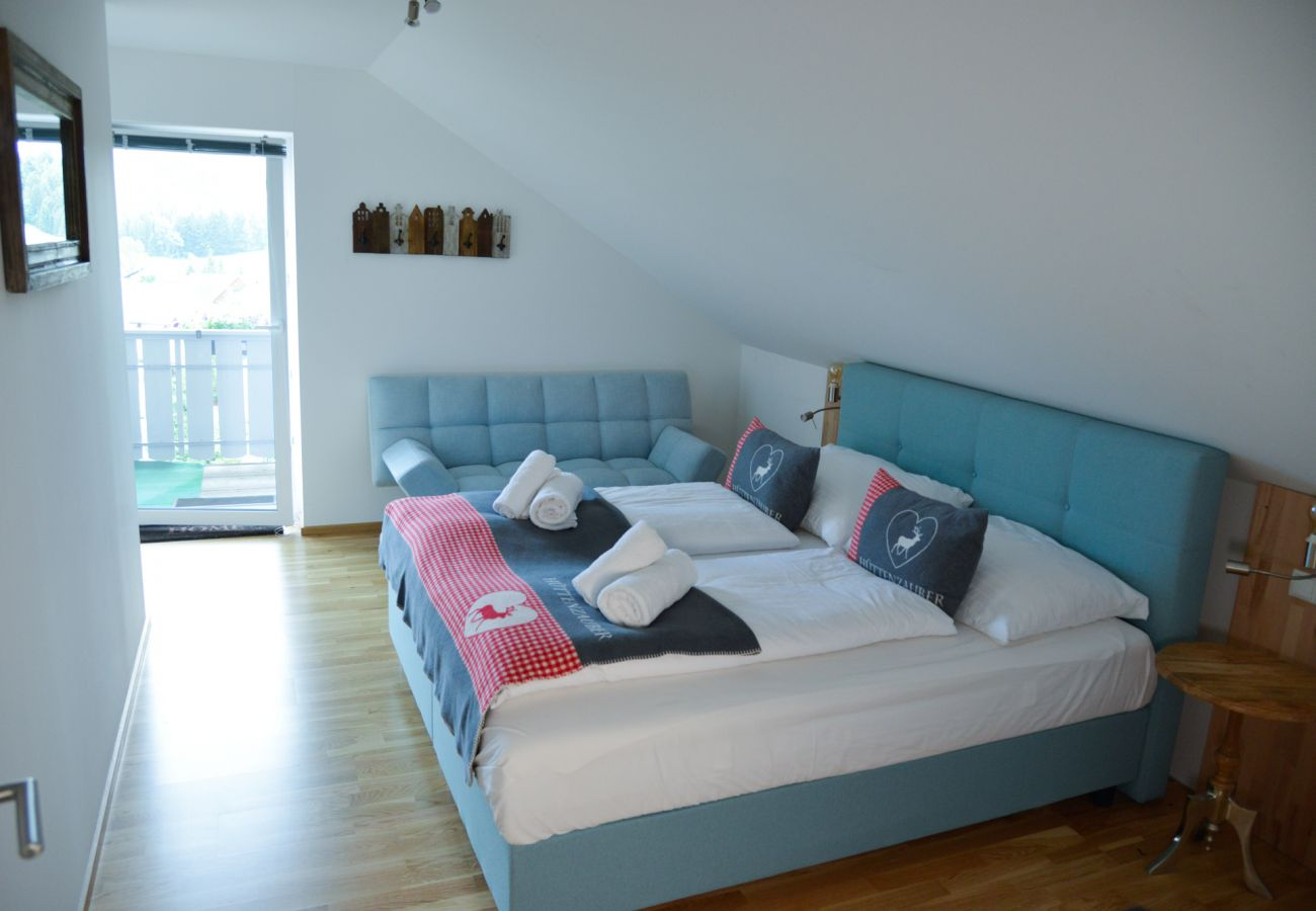 bedroom  with view to the balcony in the holiday home Grimming Lodge Goldrute in Tauplitz