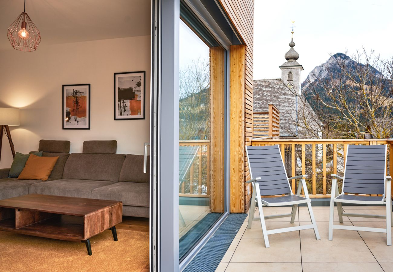 Modern terrace with seating area in the holiday home flat Adler Lodge D5 in Tauplitz