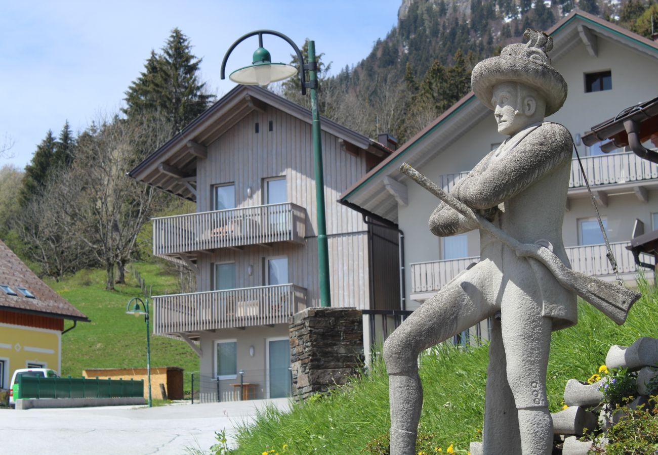 Außenansicht des Wohnhauses Grimming Lodge Windroeschen in Tauplitz