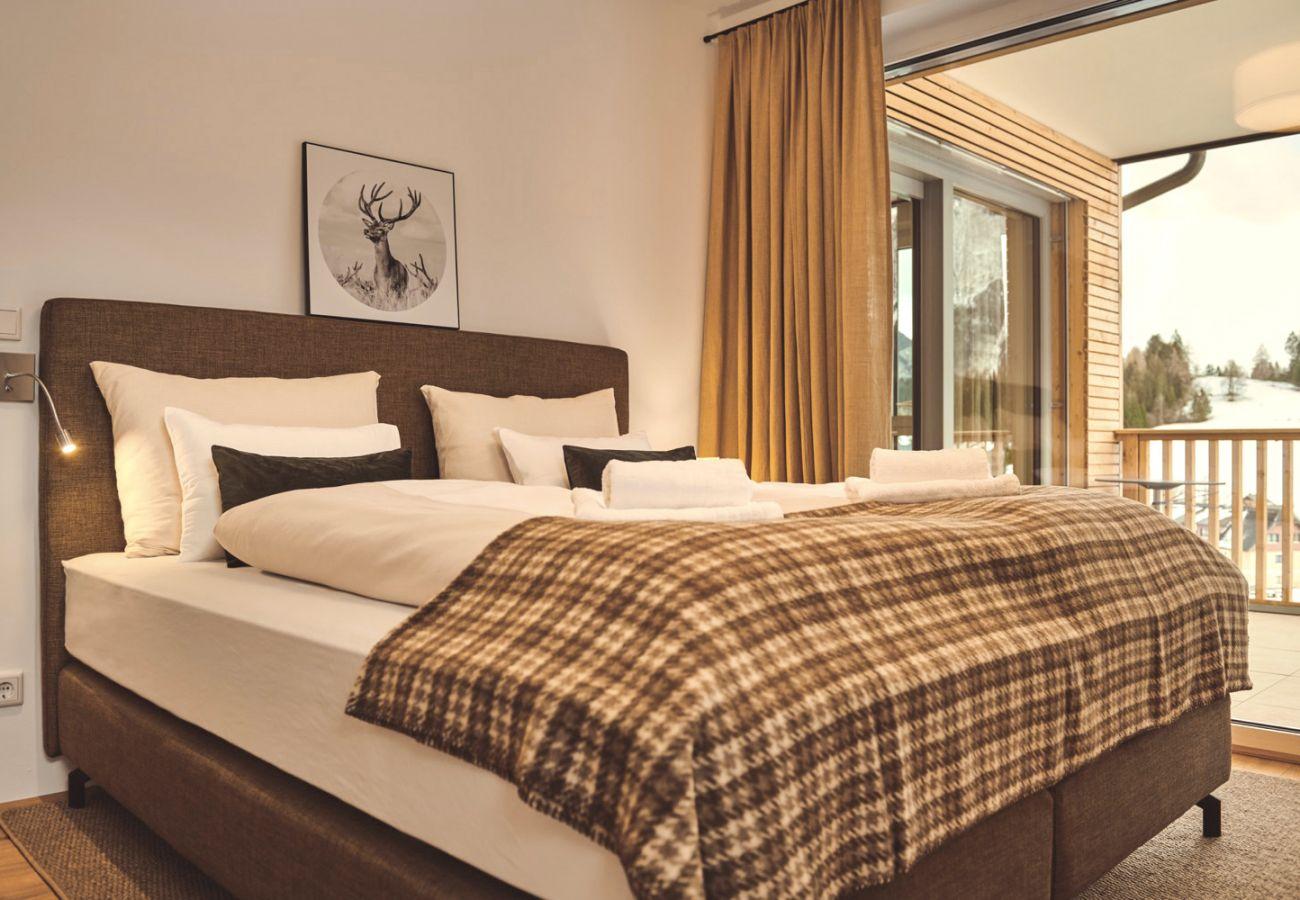 Schlafzimmer 2 in der Ferienwohnung Adler Lodge D3 in Tauplitz