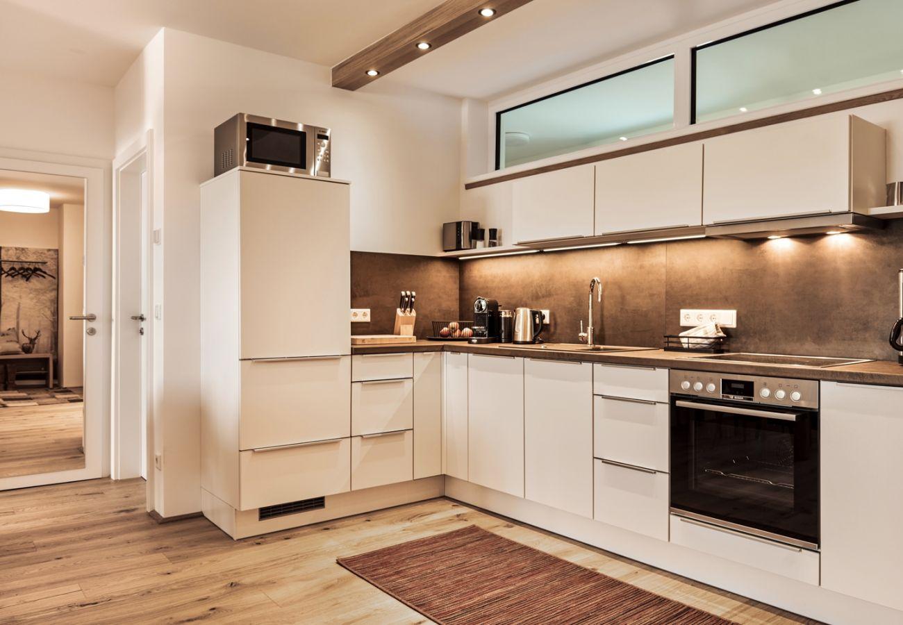 Küche in der Ferienwohnung Wasserfall Lodge C2 in Tauplitz