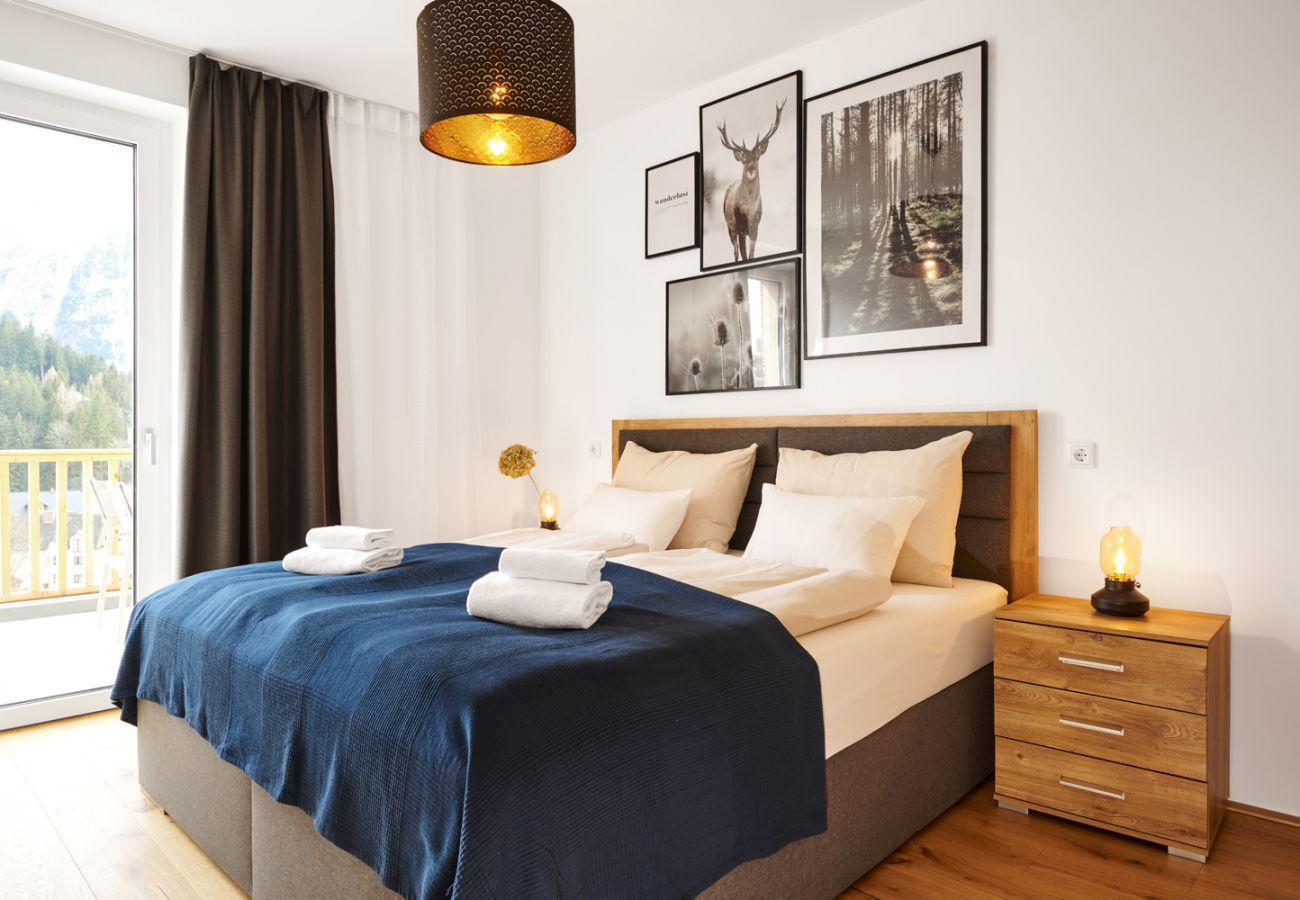 Schlafzimmer 1 in der Ferienwohnung Adler Lodge D5 in Tauplitz