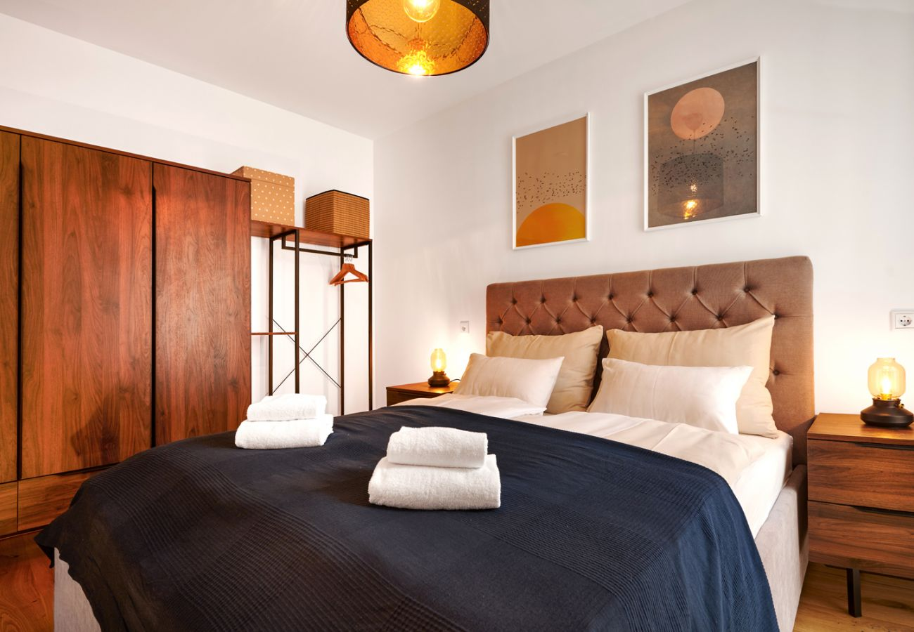 Schlafzimmer 2 in der Ferienwohnung Adler Lodge D5 in Tauplitz